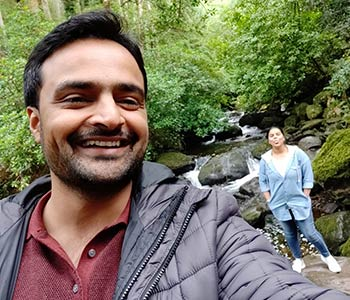 Arzoo and her husband in the forest