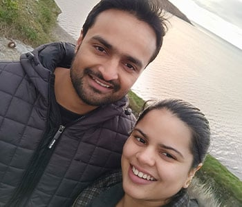 Arzoo and her husband by the water